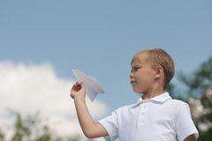 Boy with paper plane Stock Photo