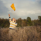 Boy with paper plane. Fun in park Stock Image