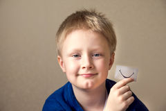 Boy with paper smile Stock Image