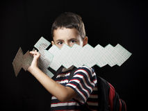 Boy with paper sword Stock Image
