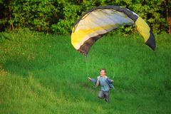 Boy and parachute near the ground Royalty Free Stock Image