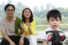 Boy with parents Stock Photography