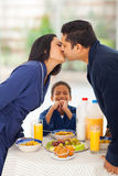 Boy parents kissing royalty free stock photo