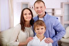 Boy with parents Stock Images