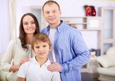 Boy with parents Royalty Free Stock Images