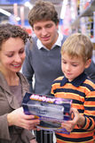 Boy with parents  in shop Stock Photography