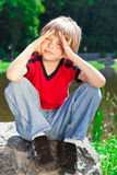 The boy at the park. The boy is sitting at the park royalty free stock image
