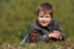 Boy in the park on the ground Stock Photography