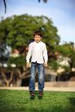 Boy in park Stock Images