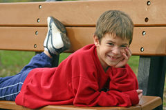 Boy on Park Bench Royalty Free Stock Photography
