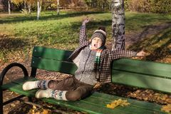 Boy on park bench yawning Royalty Free Stock Photos