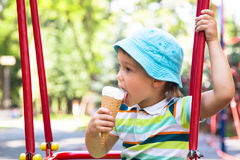Boy in the park eating ice cream Royalty Free Stock Image