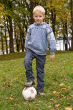 Boy in the park with a football Royalty Free Stock Photo