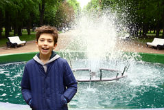 Boy in the park on fountain background Stock Image