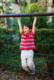 Boy in park hanging Royalty Free Stock Photo