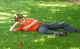 Boy in park with mp3 player Stock Photos