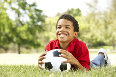 Boy In Park With Soccer Ball Stock Images