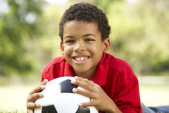 Boy In Park With Soccer Ball Stock Photos