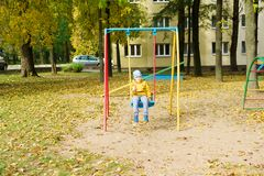 Boy in park. Boy in a yellow jacket is resting in an aun park royalty free stock photo