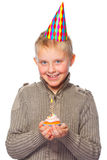 Boy with party hat and cupcake Stock Photo