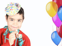 Boy with party hat and whistle. Smilling and happy boy with party hat and whistle Royalty Free Stock Photography
