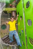 Boy passes the obstacle course, cable car.  Royalty Free Stock Image