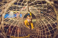 The boy passes the obstacle course in the sports club Royalty Free Stock Image