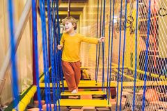The boy passes the obstacle course in the sports club Royalty Free Stock Images