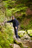 Boy passing over a mountain river Royalty Free Stock Photo