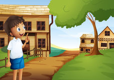 A boy at the pathway in the neighborhood Stock Image