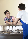 Boy Paying For Strawberry Ice Cream To Waiter At Parlor Royalty Free Stock Image
