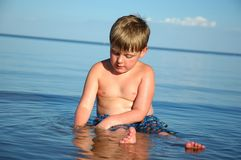 Boy in Peaceful Water Royalty Free Stock Photos