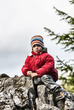 Boy on peak looking curious Royalty Free Stock Images