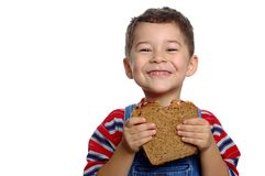 Boy and Peanut Butter Sandwich. Cute boy ready to eat a peanut butter and jelly sandwich on whole wheat bread royalty free stock photography