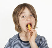 Boy with peanut flips in the mouth Stock Image