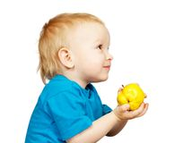 Boy with pear Royalty Free Stock Photos