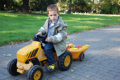 Boy with pedal car Royalty Free Stock Images