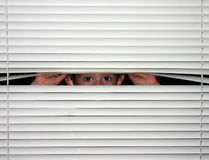 Boy Peeking out Stock Image