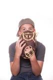 Boy Peeking out from behind baseball glove. Boy with baseball glove - Face Partially Hidden royalty free stock photos