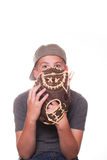Boy Peeking out from behind baseball glove Royalty Free Stock Photo