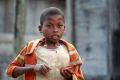 Boy peeling a fruit Royalty Free Stock Image