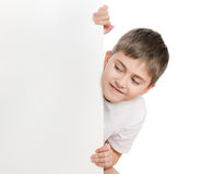 Boy Peep Out Through Poster Stock Photography
