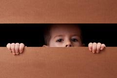 Boy peeping Stock Photos