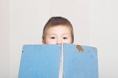 Boy peeping out from book, vintage and old book. Boy peep out from book, vintage and old book royalty free stock photography