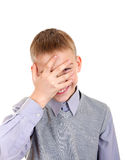 Boy Peeps through his Fingers Stock Photo