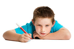 Boy with pen. Boy artist thinking with felt pen in hand. Studio white background Stock Image