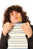 Boy with pencil and books Stock Images