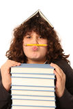 Boy with pencil and books Royalty Free Stock Images