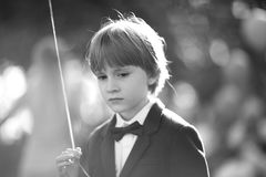 A boy. With a pensive gaze school age with a balloon in the light of the sun`s rays Royalty Free Stock Photos