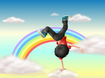 A boy performing a break dance along the rainbow vector illustration